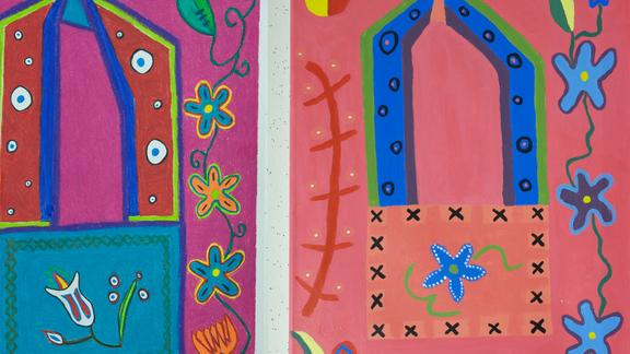 Closeup of brightly colored floral paintings