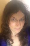 Smiling woman wearing glasses. Self-Portrait.
