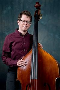 Joseph Pettit standing with upright bass