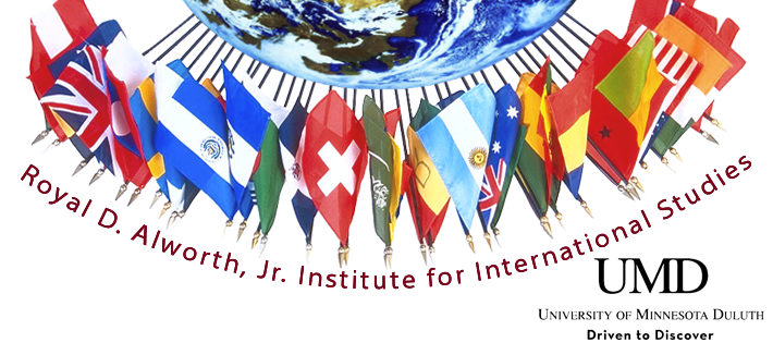 Picture of Flags sticking out of the globe-- Royal D. Alworth, Jr. Institute for International Studies