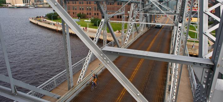 cyclist on lift bridge