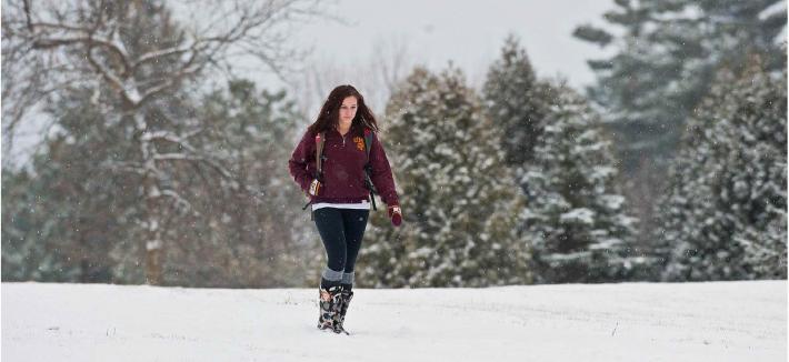 Woman walking through the snow.