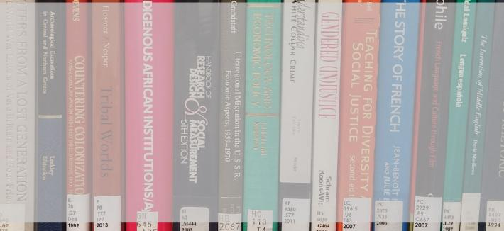 An image of the spines of a series of books, as on a bookshelf. All of the books relate to liberal arts.