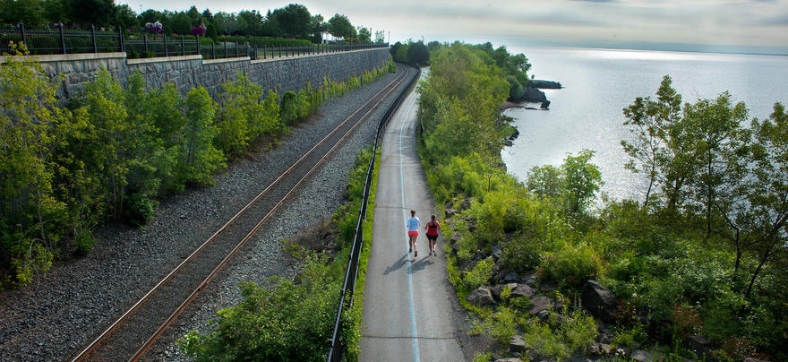 Runners on lake walk