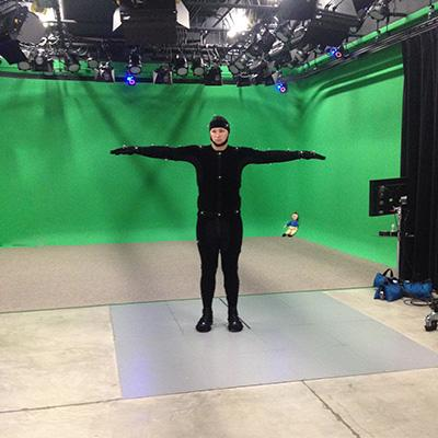 Student dressed in motion capture suit in the MMAD Lab