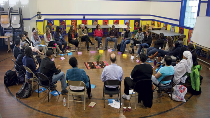 photo of group sitting in a circle